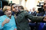 Anas Modamani Angela Merkel